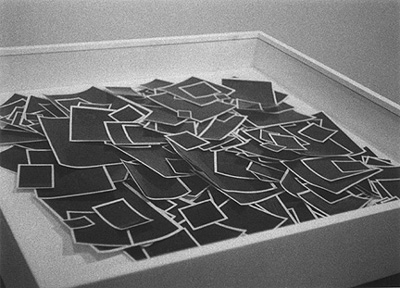 Allan McCollum. Glossies, 1980. Inks and watercolors on paper, with self-adhesive plastic laminating film. Installation: Ben Shahn Galleries, William Paterson College, Wayne, New Jersey, 1982.