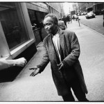 Winogrand, Street Beggar Reaching out to Receive a Donation, 1968