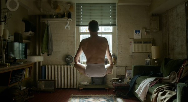 """Figure 11 After the opening credits, and just prior to the beginning of the """"single take"""" that will constitute the majority of the film Riggan is seen from behind in his dressing room, levitating feet above the ground in a yogic lotus position."""