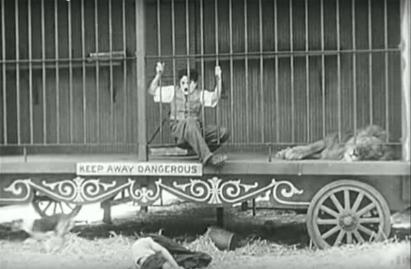 "Figure 6 Figs. 4-6: According to Bazin, in Chaplin's The Circus (1928), individual takes of Chaplin and the Lion (Figs. 4-5) are given greater comedic and aesthetic power by longer takes of Chaplin actually in the presence of the lion (Fig. 6). The cage becomes a space of comedy because of what Bazin called the ""comedy of space"": the scene's uninterrupted duration of time and unity of space provide a suitable platform for the high risks of humor (52)."