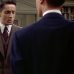 Figure 9  Figs. 7-9: Hitchcock famously masked the 11 cuts in Rope (1948), each of which lasts between three and nine minutes, o!en by focusing on a dark object, allowing for a momentary blackout so that the camera could be reloaded or refocused. Here the camera pans toward the back of Brandon's suit, cuts, and then pans back up over his shoulder.
