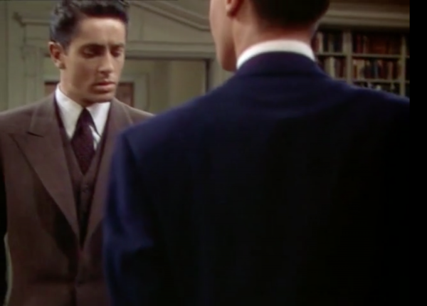 Figure 9 Figs. 7-9: Hitchcock famously masked the 11 cuts in Rope (1948), each of which lasts between three and nine minutes, often by focusing on a dark object, allowing for a momentary blackout so that the camera could be reloaded or refocused. Here the camera pans toward the back of Brandon's suit, cuts, and then pans back up over his shoulder.